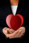 Woman_Holding_Heart_iStock_000002769679Small